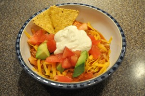 Top with fresh tomatoes, cheddar cheese, avocados, tortilla chips and sour cream!